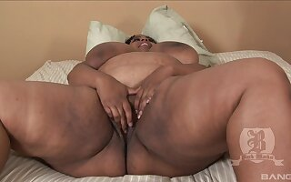 Fat black woman Madame Trixie spreads her legs for nasty sex