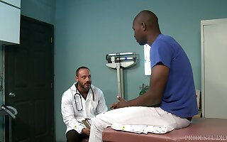 Mature gay doctor takes his patient's big black dick at the office