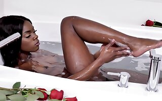 Ebony beauty showers her sensible pussy and clit