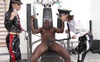 Black man obeys two females for a wild femdom threesome