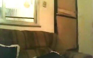 Masked ebony girl makes a sextape on the sofa