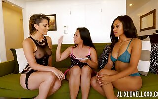 Alix Lovell, Anya Ivy with the addition of Lucky Starr are playing with one vibrator